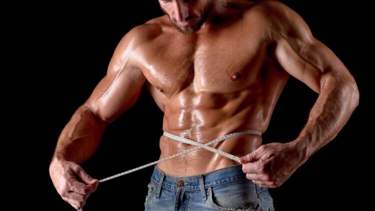 Bodybuilder with tape measure around chest