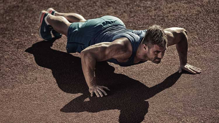 Handsome muscular man doing push-up
