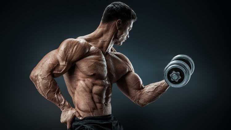 Bodybuilder doing bicep curl with hand on hip